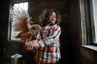 Adar Fainsilber, 5, fed the fowl at his home in Morrisville, Vt. His father is the rabbi at the Jewish Community of Greater Stowe.